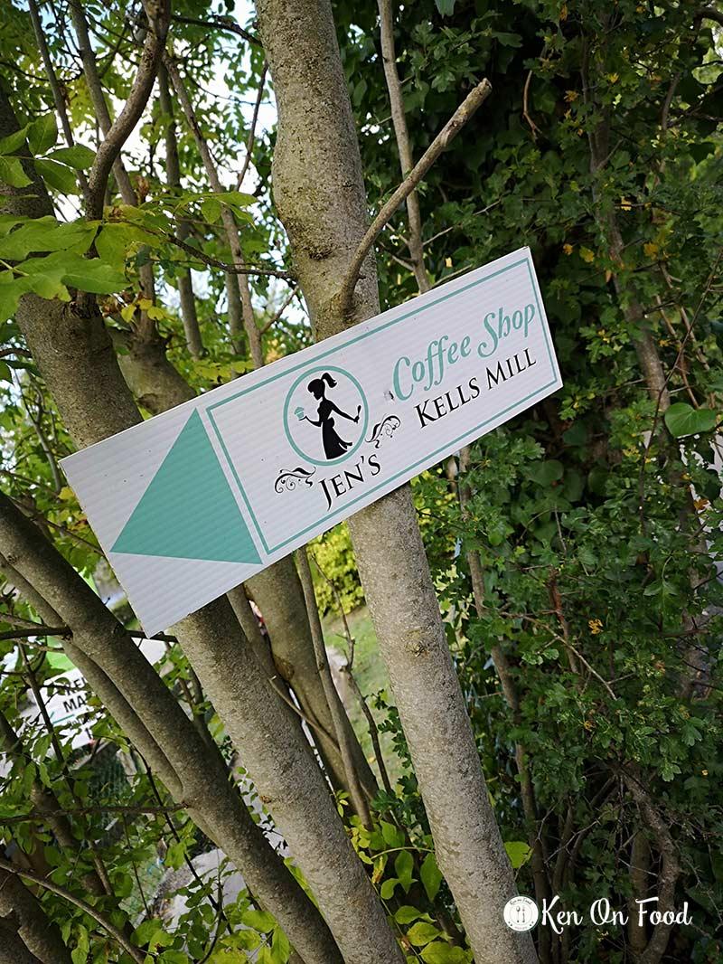 Signpost for Jen's coffee shop at Kells mill (Mullins' Mill)
