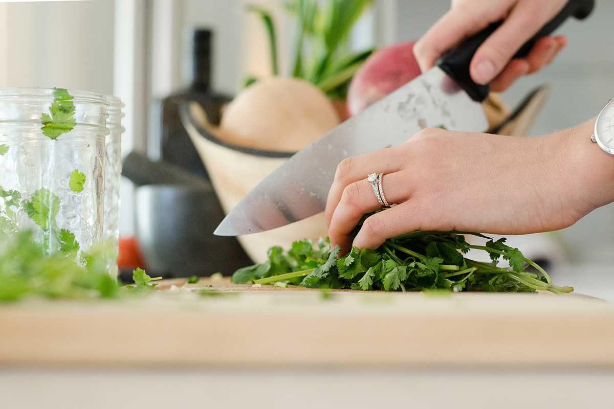 Chopping vegetables. Photo: Alyson McPhee/Unsplash