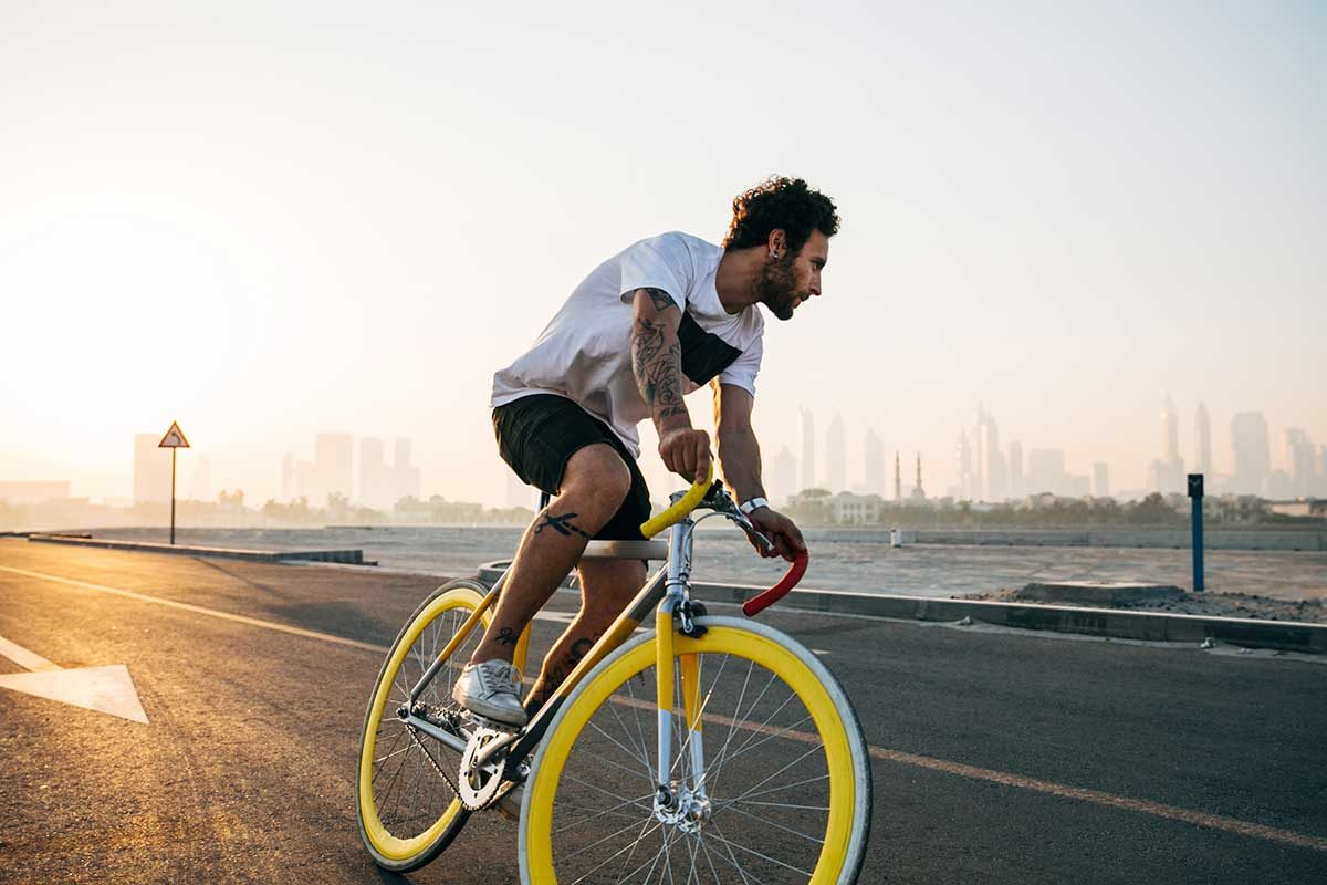 Man riding bike. Photo: Jonny Kennaugh/Unsplash