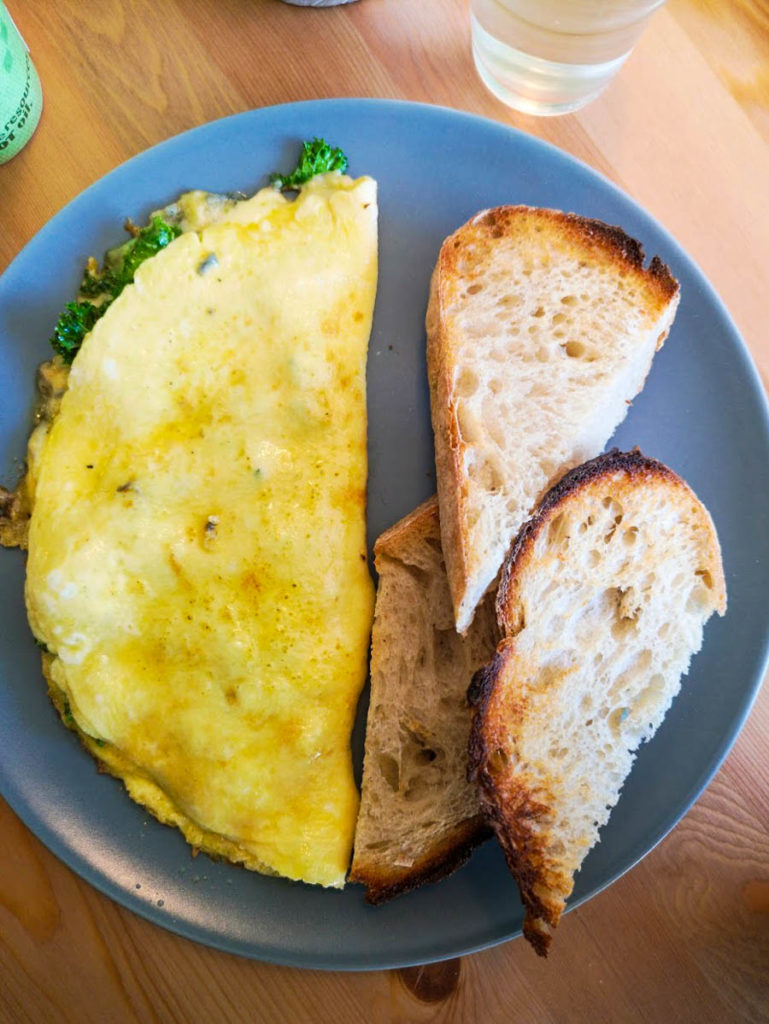 Three egg omelette with kale, Cashel Blue cheese and sourdough toast.