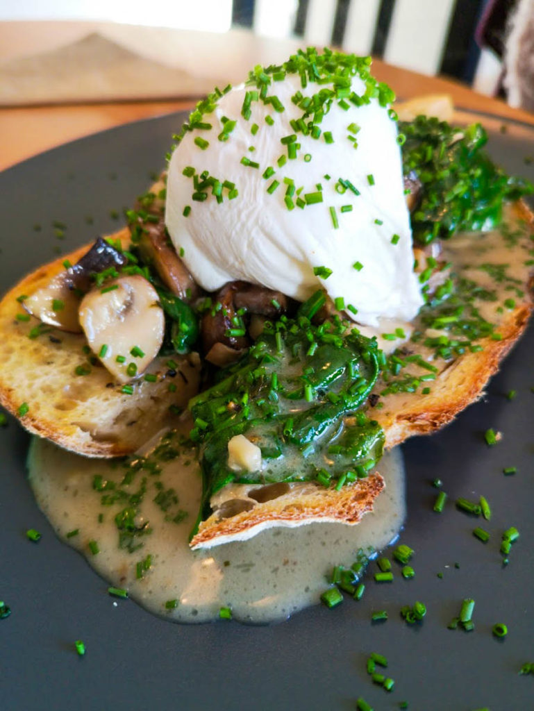 Chestnut mushrooms with spinach on sourdough, topped with a poached egg.
